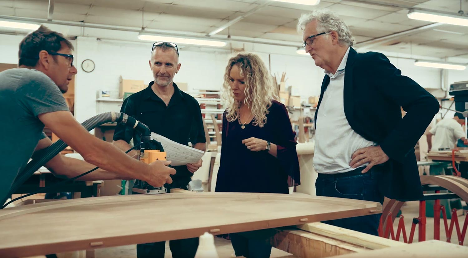 Davidson team discussing the Howes Table manufacturing process