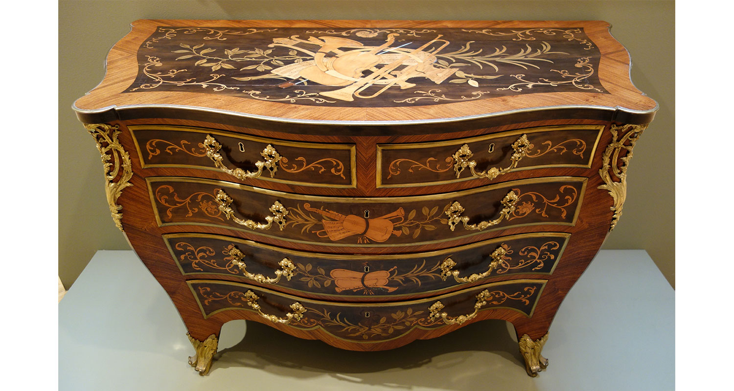 Above: Marquetry is a centuries-old technique traditionally associated with cabinet making. (source: Wikicommons)